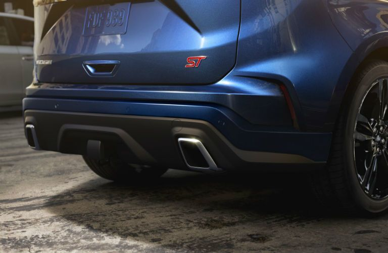 rear bumper of a blue 2021 Ford Edge ST