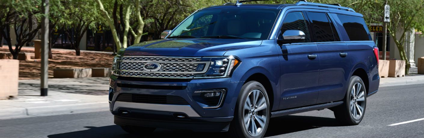 side view of a blue 2021 Ford Expedition Platinum