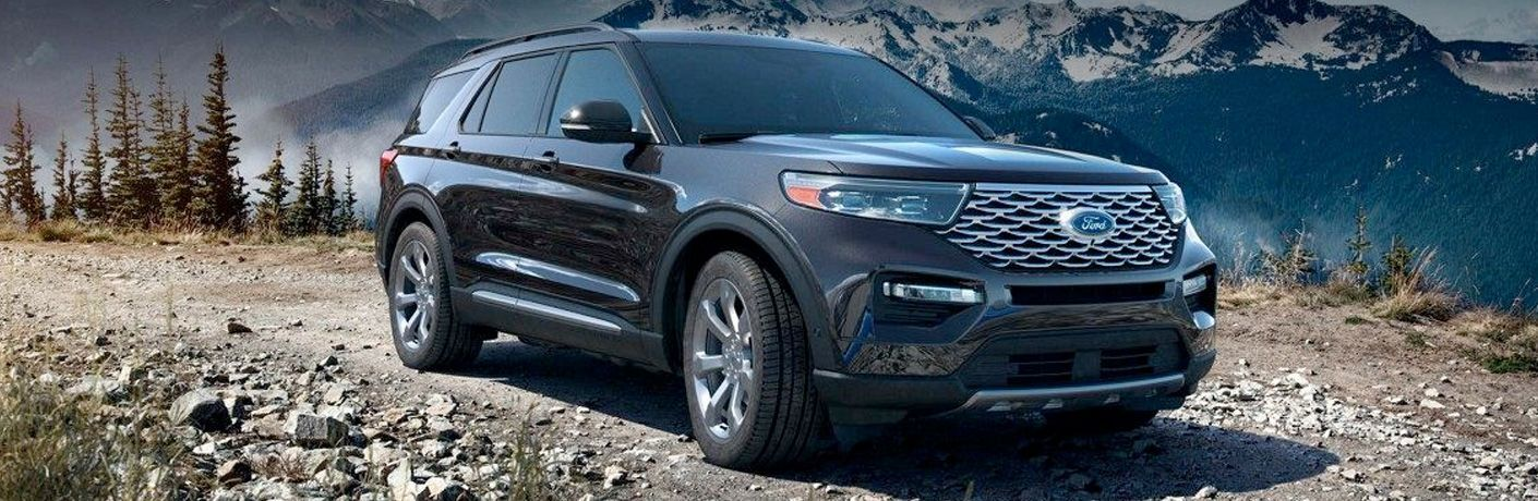 side view of a black 2021 Ford Explorer Hybrid