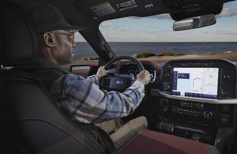 man using the infotainment system in his 2021 Ford F-150 Hybrid