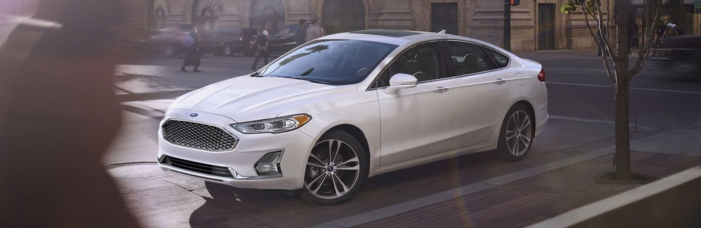 side view of a white 2021 Ford Fusion Hybrid