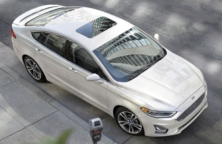 aerial view of a white 2021 Ford Fusion Hybrid