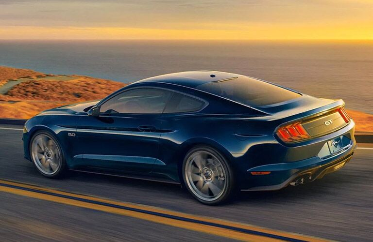 2021 Ford Mustang on road in blue