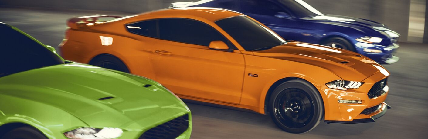 side view of three 2021 Ford Mustang models