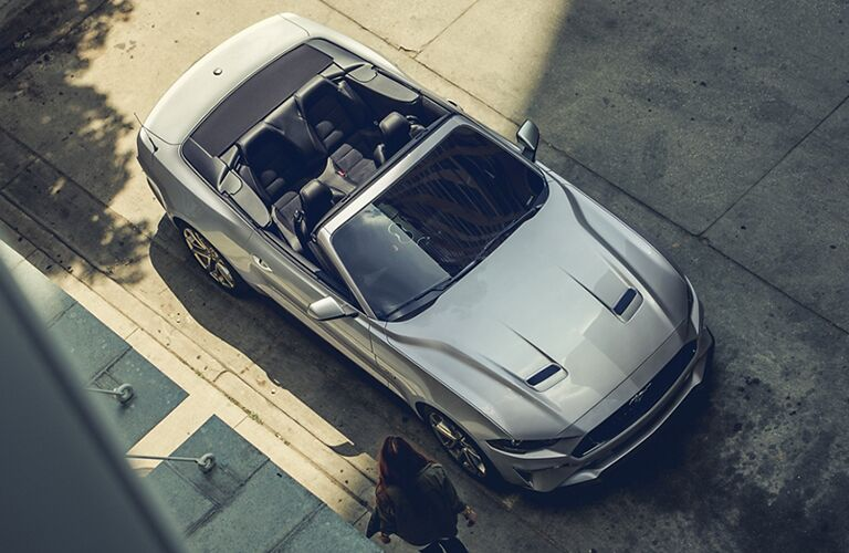 aerial view of a silver 2021 Ford Mustang convertible with the top down
