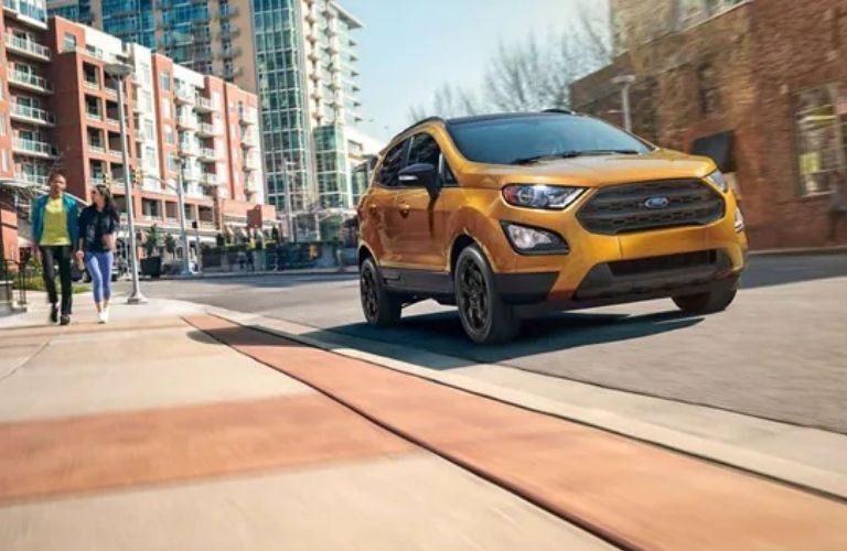 2021 Ford EcoSport SES in gold on the road with people walking nearby