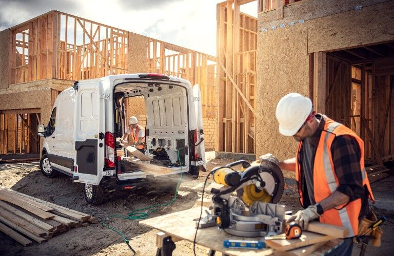 construction workers using power generator of the 2022 Ford E-Transit
