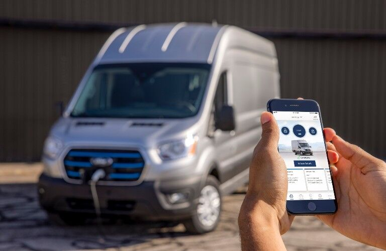 person using cell phone to check on their 2022 Ford E-Transit