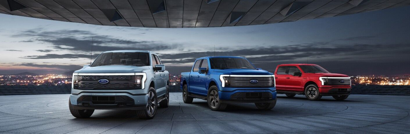 three 2022 Ford F-150 Lightning trucks