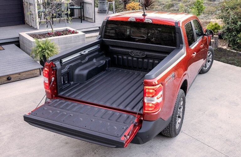 empty cargo bed of a red 2022 Ford Maverick