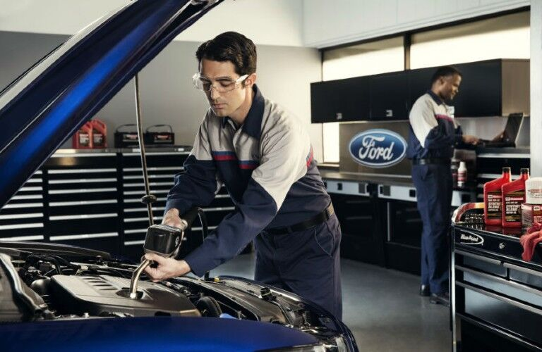 Ford tech working under the hood