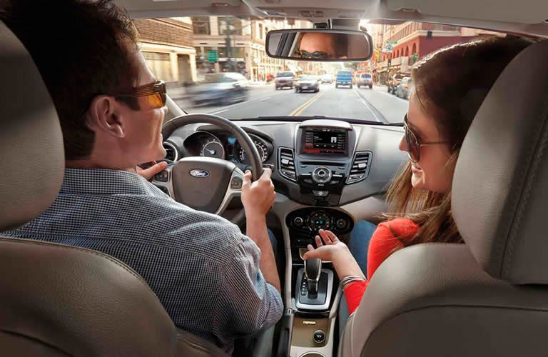 couple in front interior of a Ford Escape