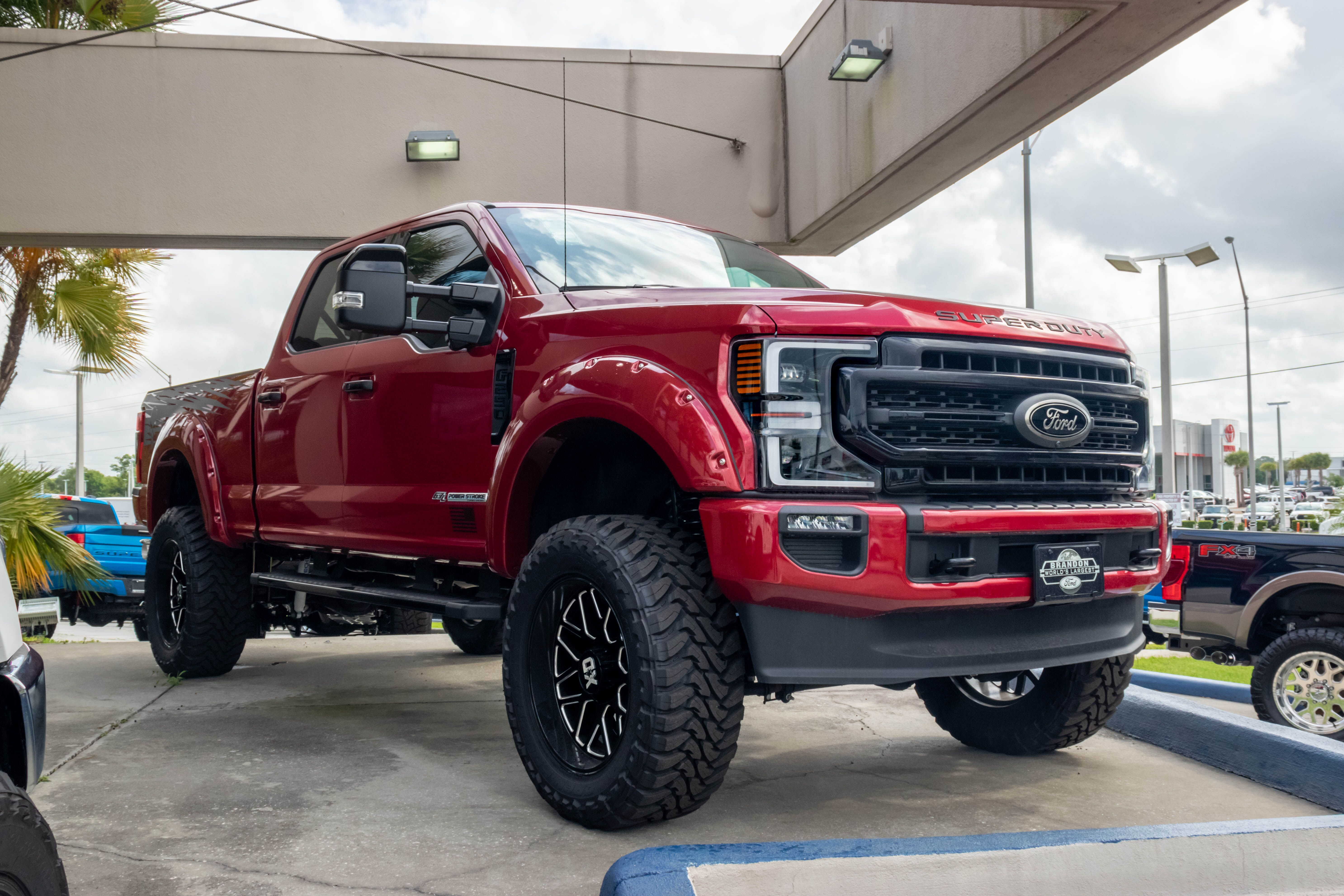 side view of a red Ford F-150