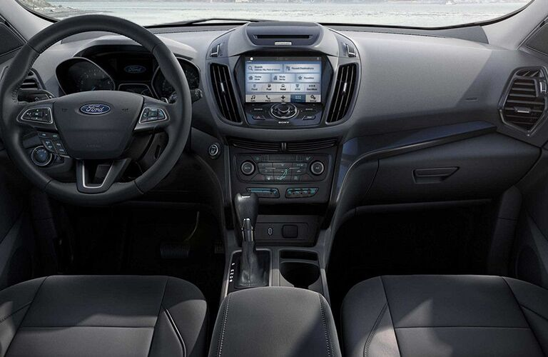 driver dash and infotainment system of a used 2018 Ford Escape