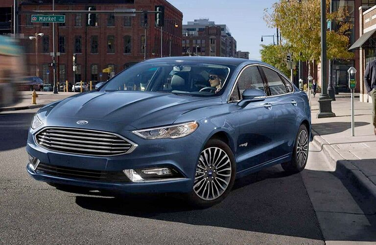 front view of a blue 2018 Ford Fusion Hybrid