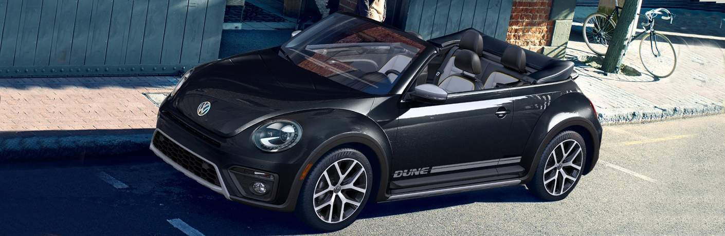 2018 VW Beetle Convertible Dune trim exterior front side view with convertible top lowered