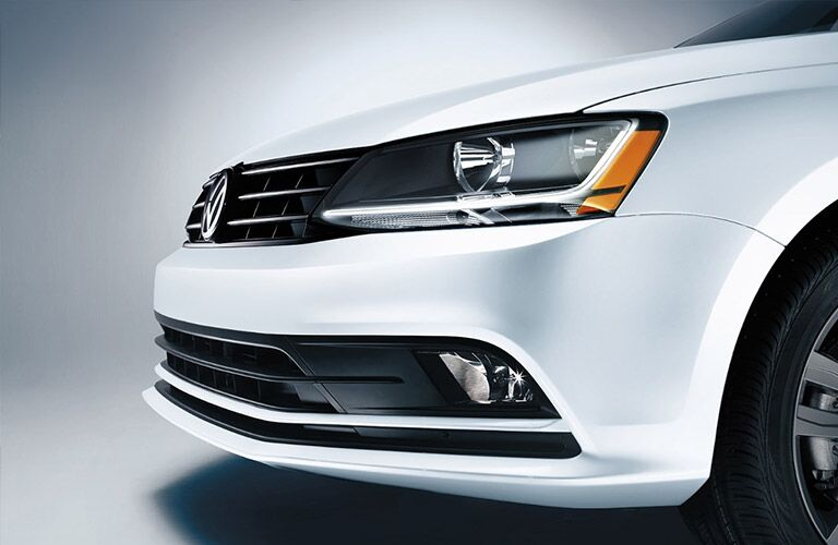 2018 VW Jetta Close-up view of White Exterior Headlight and Grille