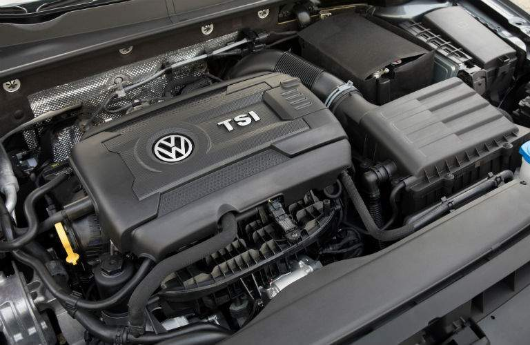 engine bay and under the hood view of 2018 volkswagen golf sportwagen tsi engine