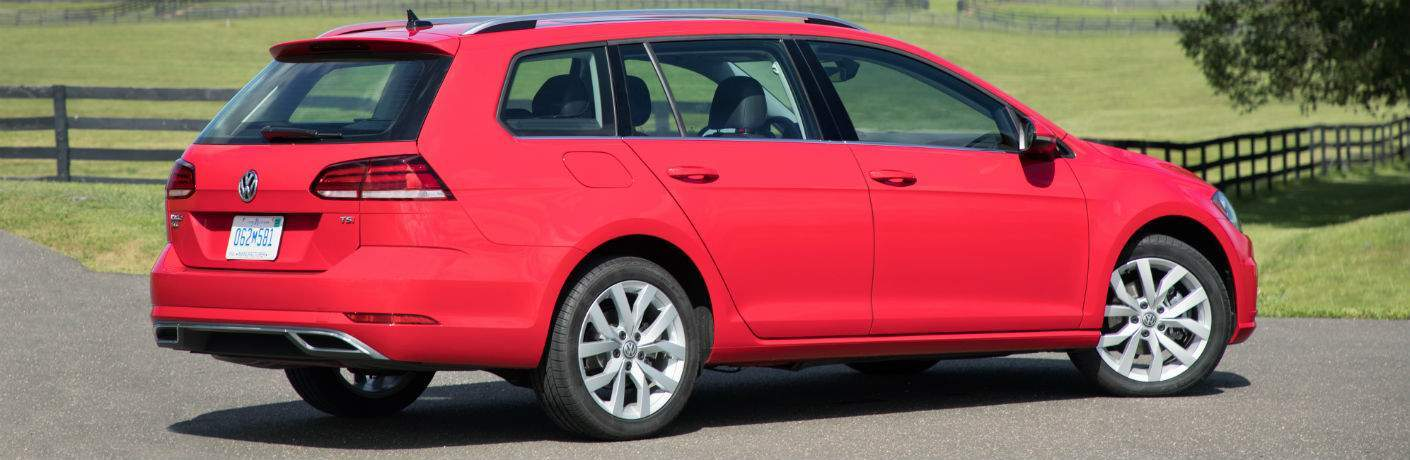 2018 volkswagen golf sportwagen shown in parking lot for stable or farm in bright red color