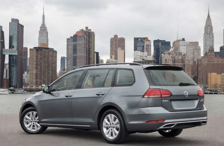 2018 volkswagen golf sportwagen parked in front of new york city skyline rear view in gray color