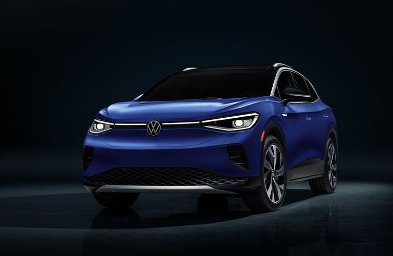 Front and side exterior view of a blue-colored 2021 Volkswagen ID.4