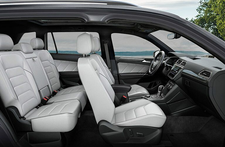 Interior front row and second row of the 2021 Volkswagen Tiguan as seen from the side
