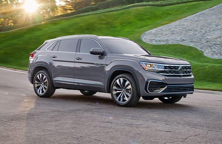 2021 Volkswagen Atlas Cross Sport parked by green grass on road