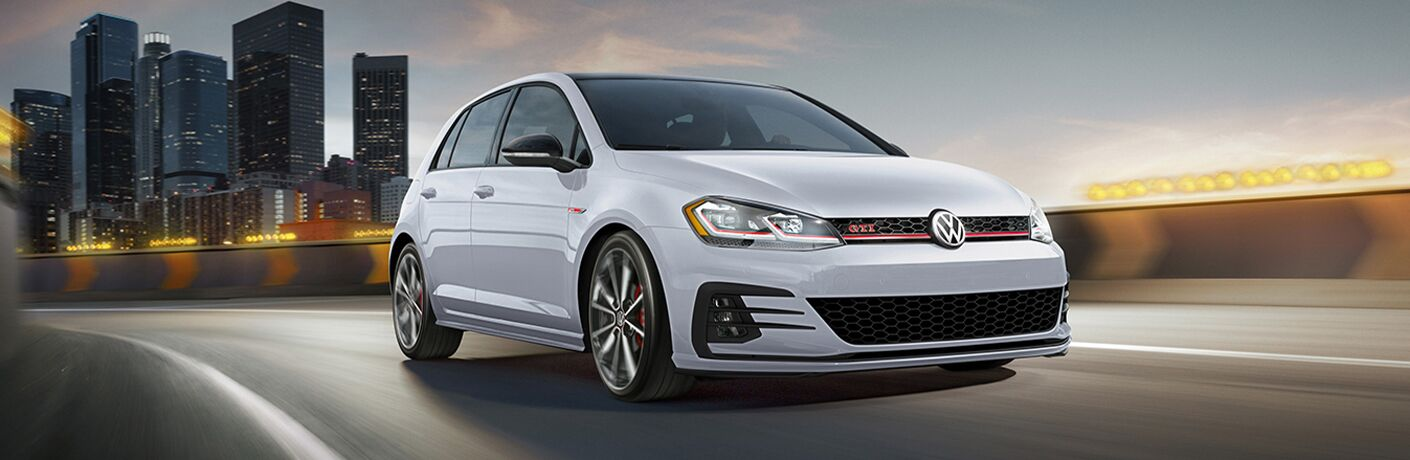 2021 Volkswagen Golf GTI driving on a road
