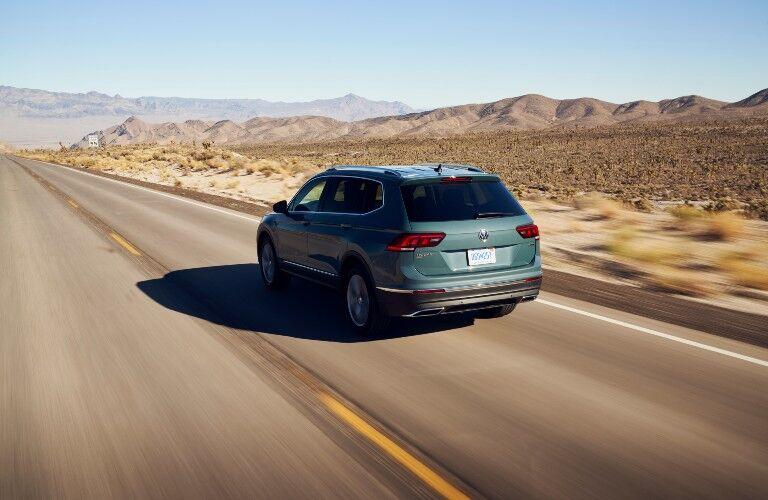 2021 Volkswagen Tiguan driving away on desert road