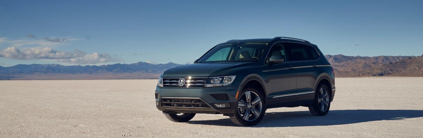 2021 Volkswagen Tiguan parked on flat desert with distant mountains