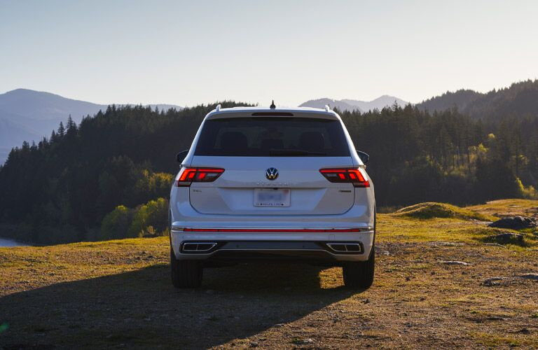 Back view of 2022 Volkswagen Tiguan parked in front of mountains
