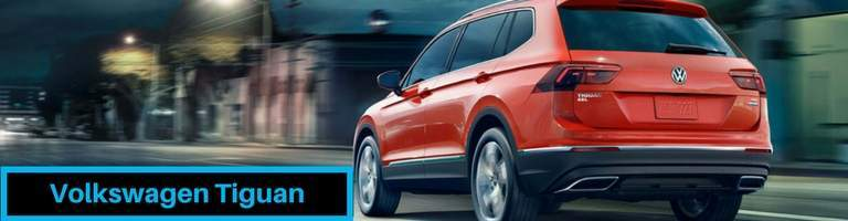 2018 volkswagen tiguan shown on city street at night in stunning red color