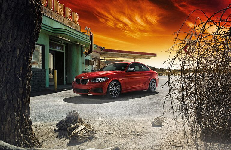 Red 2017 BMW 2 Series Coupe Parked in Front of a Diner in the Desert