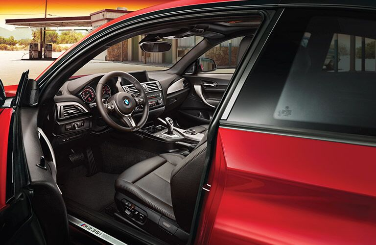Red 2017 BMW 2 Series with Front Driver's Side Door Open to Show Front Seat Interior