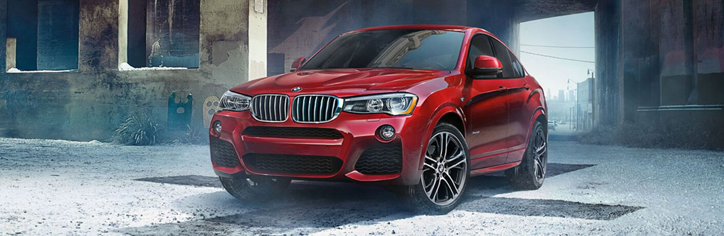 Red 2017 BMW X4 Parked in an Alley