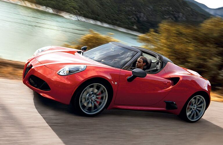 Red 2018 Alfa Romeo 4C Spider on Coastal Road