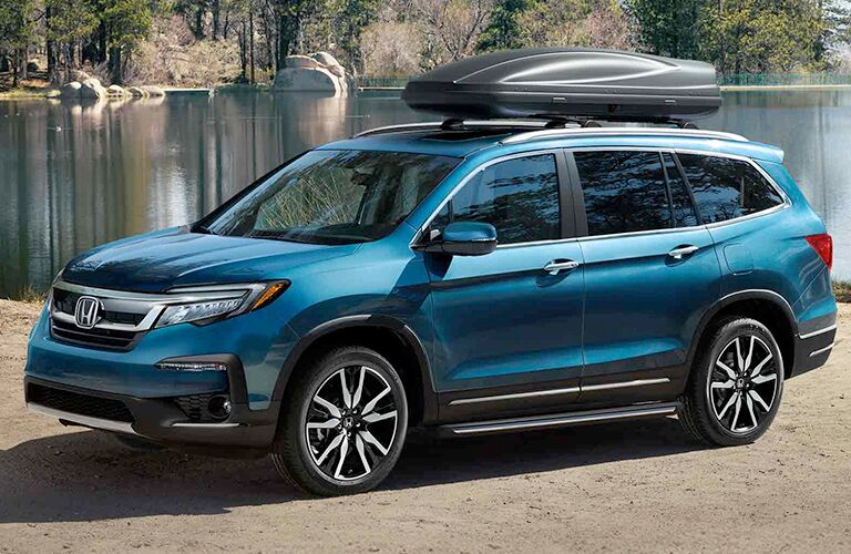 Blue 2019 Honda Pilot Next to a Lake