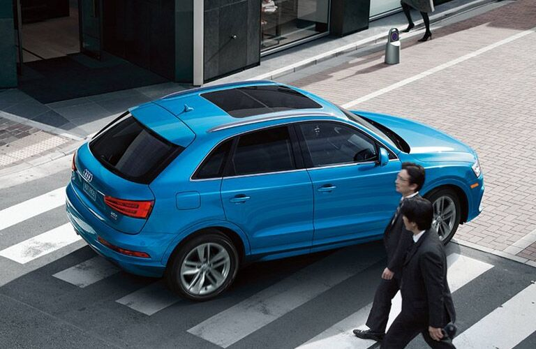 Overhead View of a Blue 2016 Audi Q3 on a City Street