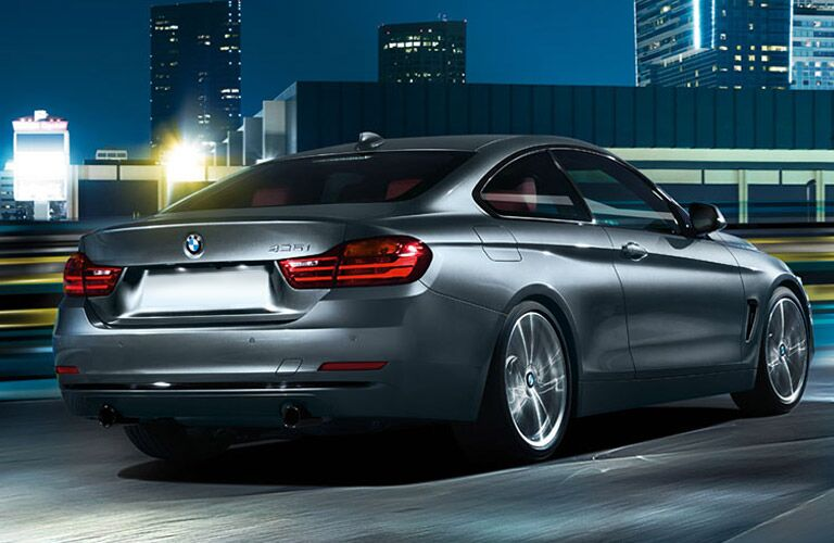 Gray 2016 BMW 4 Series Rear Exterior on City Road at Night