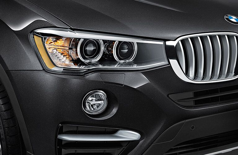 Close Up of 2016 BMW X4 Headlights and Grille