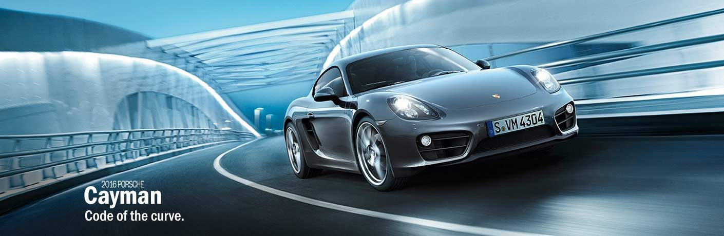 Gray 2016 Porsche Cayman on Bridge with White 2016 Porsche Cayman Code of the Curve Text in Foreground