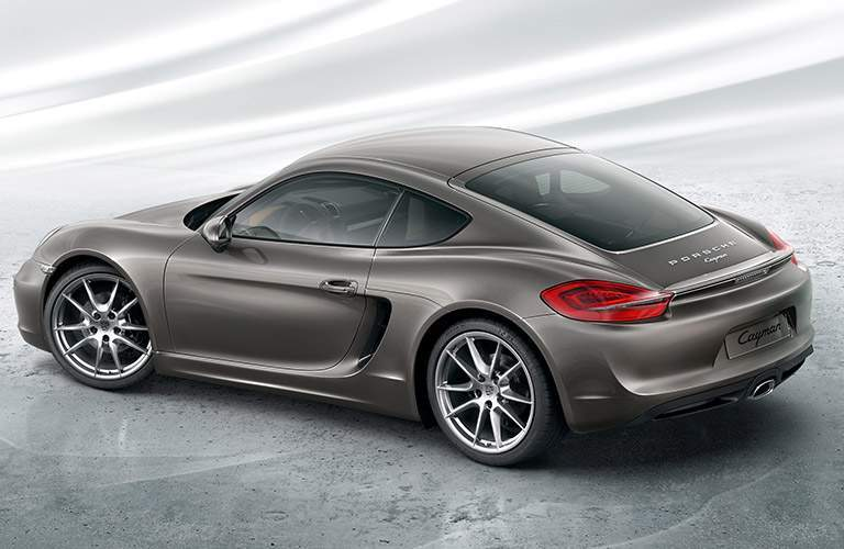 Gray 2016 Porsche Cayman Rear Exterior on White Background