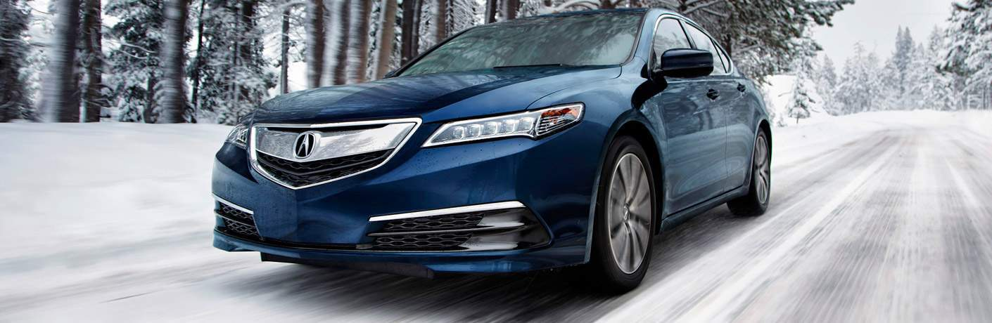 Blue 2017 Acura TLX Driving on Snow-Covered Road