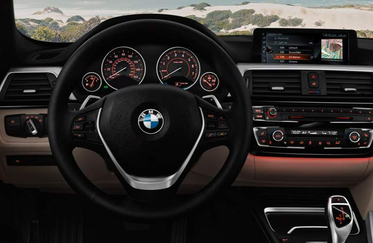 2017 BMW 3 Series Steering Wheel and Center Console Dashboard with Red Ambient Lighting