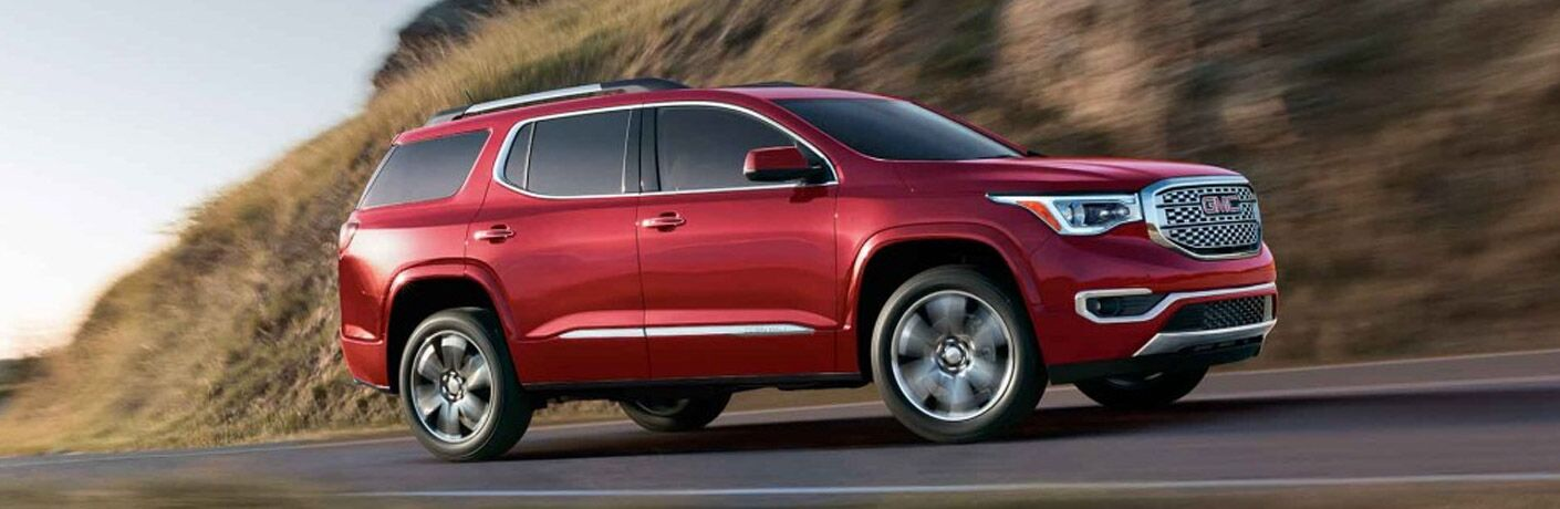 Red 2017 GMC Acadia on a Highway