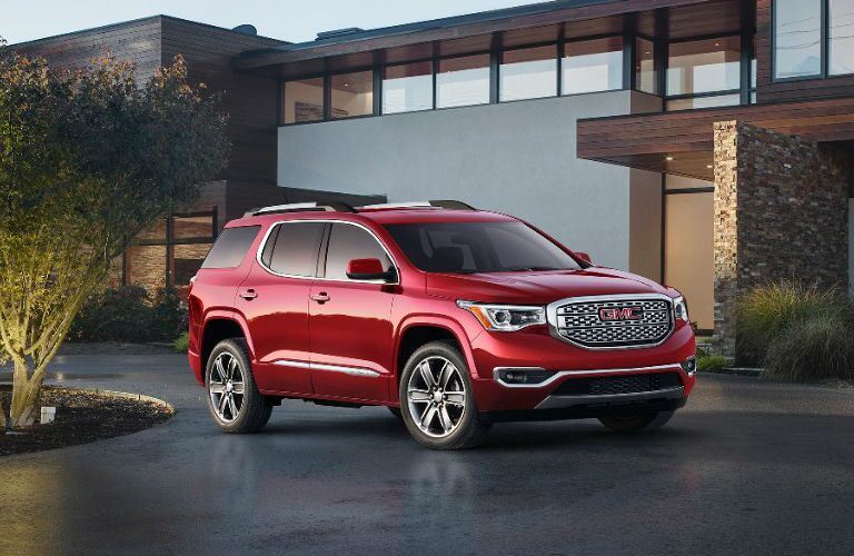 Red 2017 GMC Acadia Parked in a Driveway