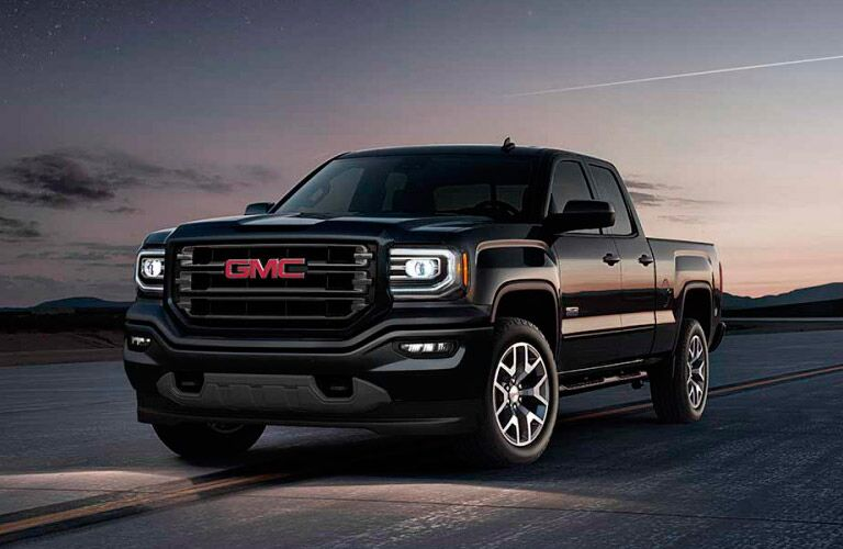 Black 2017 GMC Sierra 1500 Driving on a Country Road at Night