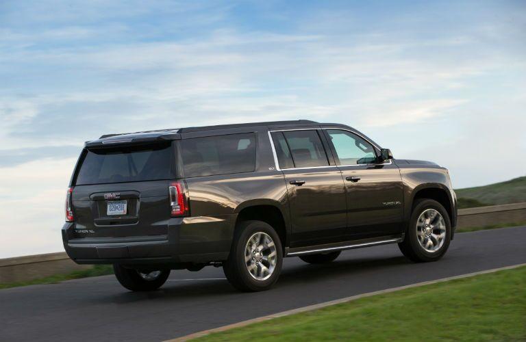 Black 2017 GMC Yukon XL Driving Up a Hill