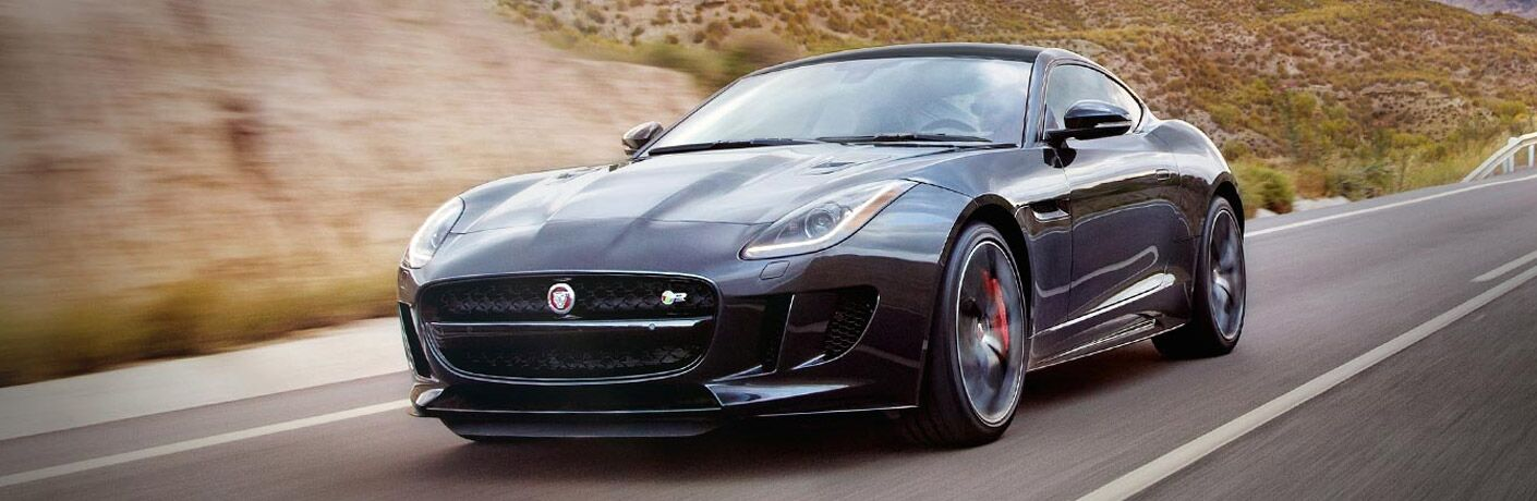 Black 2017 Jaguar F-TYPE on a Country Highway