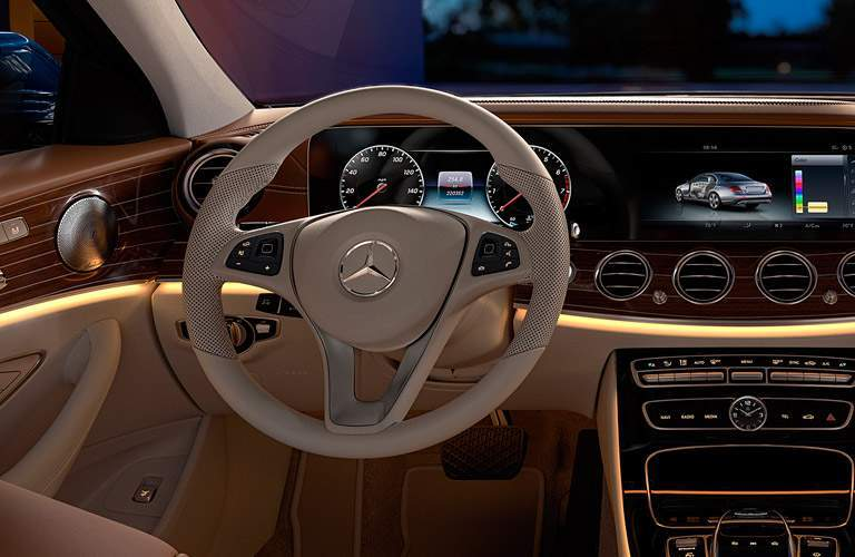 2017 Mercedes-Benz E-Class Steering Wheel and COMAND Touchscreen at Night with Yellow Ambient Interior Lighting